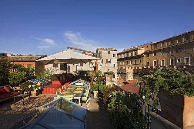 Terrazze romane lo spettacolo della capitale dall alto for Progettista giardini