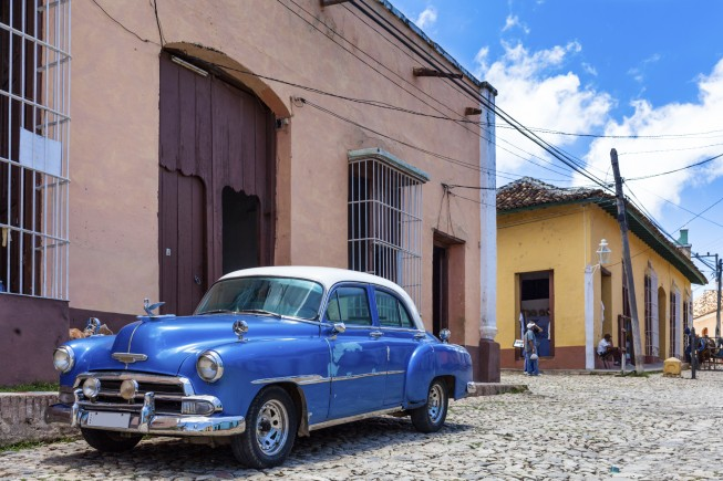Blue american classic car parked in havana cuba