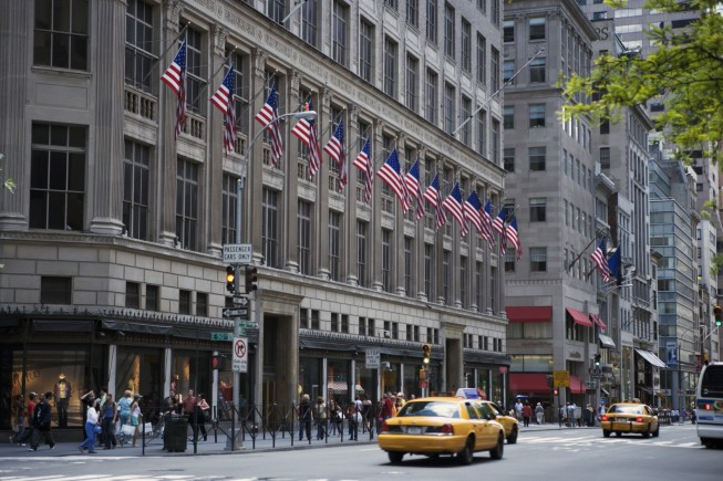 American flags on department store and street scene, New York City, NY, USA