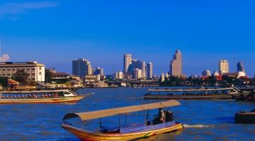 Longtail boat and city skyline, Bangkok, Thailand