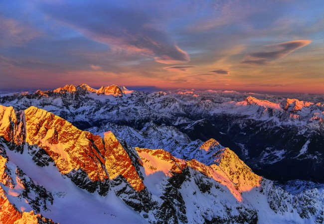 Aerial view of Mount Disgrazia and Bernina Group at sunset Masino Valley Valtellina Lombardy Italy Europe