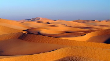 Image capturing the stunning view of the Dunes under the blue sky, in Oman