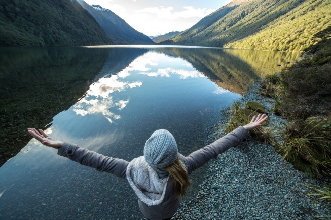 Young woman in nature embracing life and freedom
