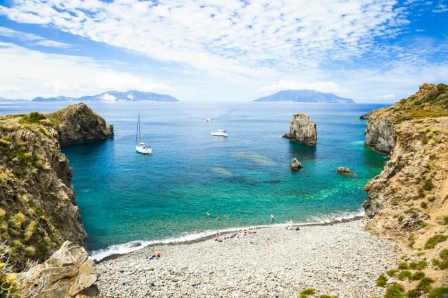 Cala Junco - small bay of Panarea - one of Aeolian Islands near Sicily (Italy). Lipari and Salina islands visible on the horizon.