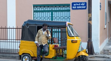 Tamil tuk-tuk driver in old France in India