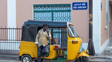 Tamil tuk-tuk driver in old France in India