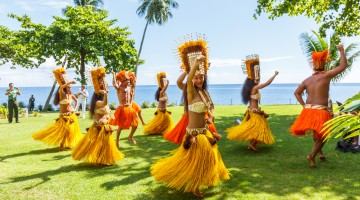 Polynesian women perform traditional dance in Tahiti  Papeete, French Polynesia. Polynesian dances are major tourist attraction of luxury resorts of French Polynesia