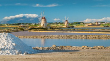 "Windmills at the natural reserve of the ""Saline dello Stagnone"" near Marsala and Trapani, Sicily."