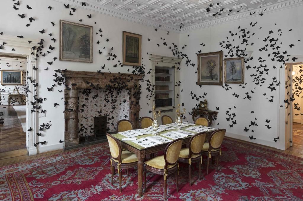Un interno della Fondazione Pini con l'installazione Black Cloud di Carlo Amorales