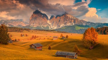 Seiser Alm and Langkofel group at colorful sunset, Dolomites, Italy