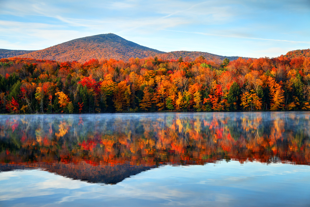 Early morning autumn light near Killington, Vermont. Photo taken on a calm tranquil colorful morning during the peak autumn foliage season. Vermont's beautiful fall foliage ranks with the best in New England bringing out some of  the most colorful foliage in the United States