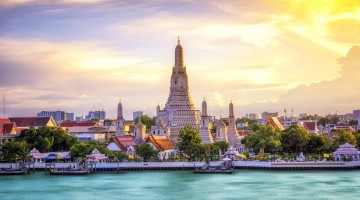 Thai Temple at Chao Phraya River Side, Sunset at Wat Arun Temple in Bangkok Thailand. Wat Arun is a Buddhist temple in Thon Buri District of Bangkok, Thailand, Wat Arun is among the best known of Thailand's landmarks