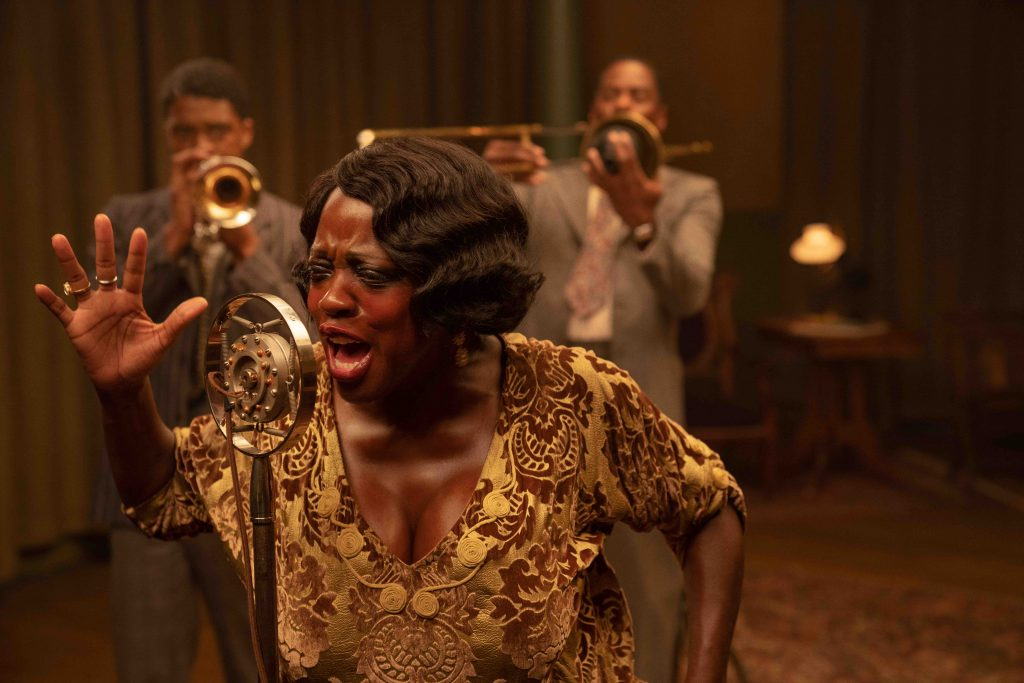 Ma Rainey's Black Bottom (2020): (L to R), Chadwick Boseman as Levee, Viola Davis as Ma Rainey, Colman Domingo as Cutler. Cr. David Lee / Netflix